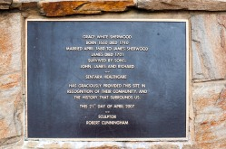 Plaque on the base of Sherwood's Statue