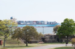 A cargo ship passes Fort Monroe and her outer defenses at Hampton Roads