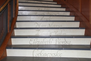 "Names of the women in Virginia are displayed on the ""Tenacity"" exhibition stairway. Jamestown-Yorktown Foundation Photo."