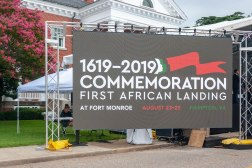 Welcome sign on monitors outside of Fort Monroe's grounds.