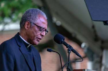 Reverend Walter Barrett, Jr. delivering the benediction.